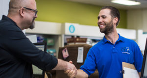 Happy-customer-shaking-hands-with-PPM-surveyor